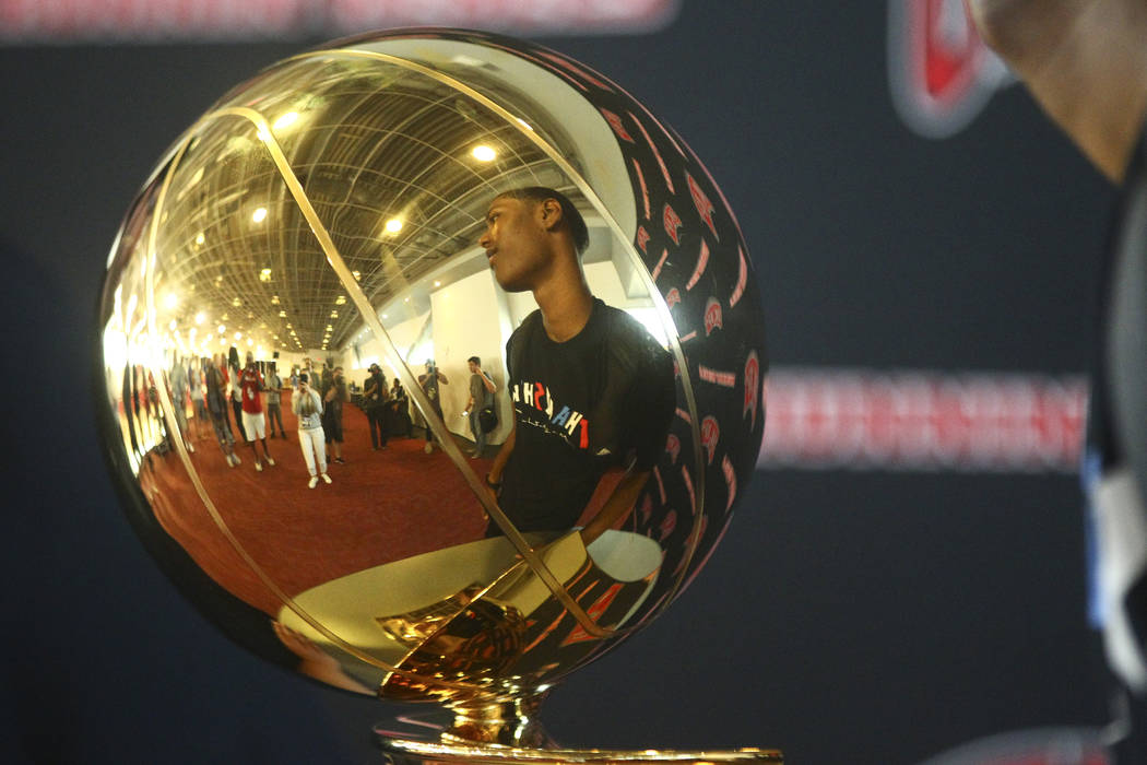 Golden State Warriors' Patrick McCaw is reflected in the Larry O'Brien Trophy in Mendenhall Center at UNLV in Las Vegas on Friday, July 14, 2017. Chase Stevens Las Vegas Review-Journal @csstevensphoto