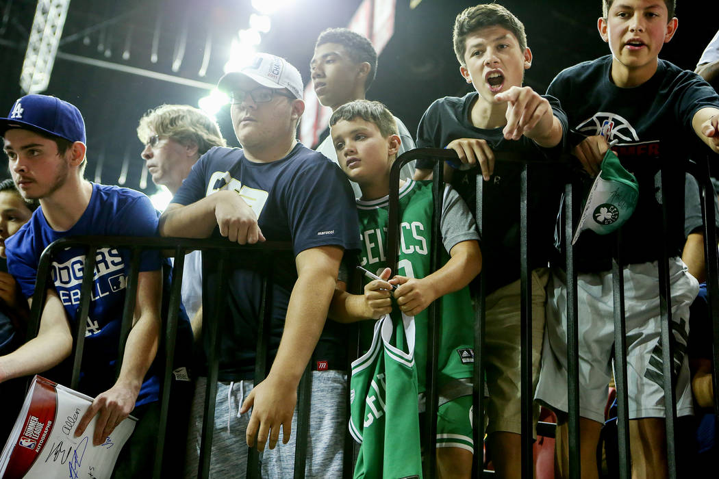Fans cheer and beg for autographs as Boston Celtics players walk past during their 2017 NBA Summer League game against the Dallas Mavericks at Thomas & Mack in Las Vegas on Saturday, July 15,  ...