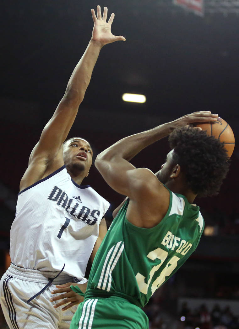 Dallas Mavericks guard Dennis Smith Jr. attempts to block Boston Celtics player Perrin Buford's shot during their 2017 NBA Summer League game at Thomas & Mack in Las Vegas on Saturday, July 15 ...