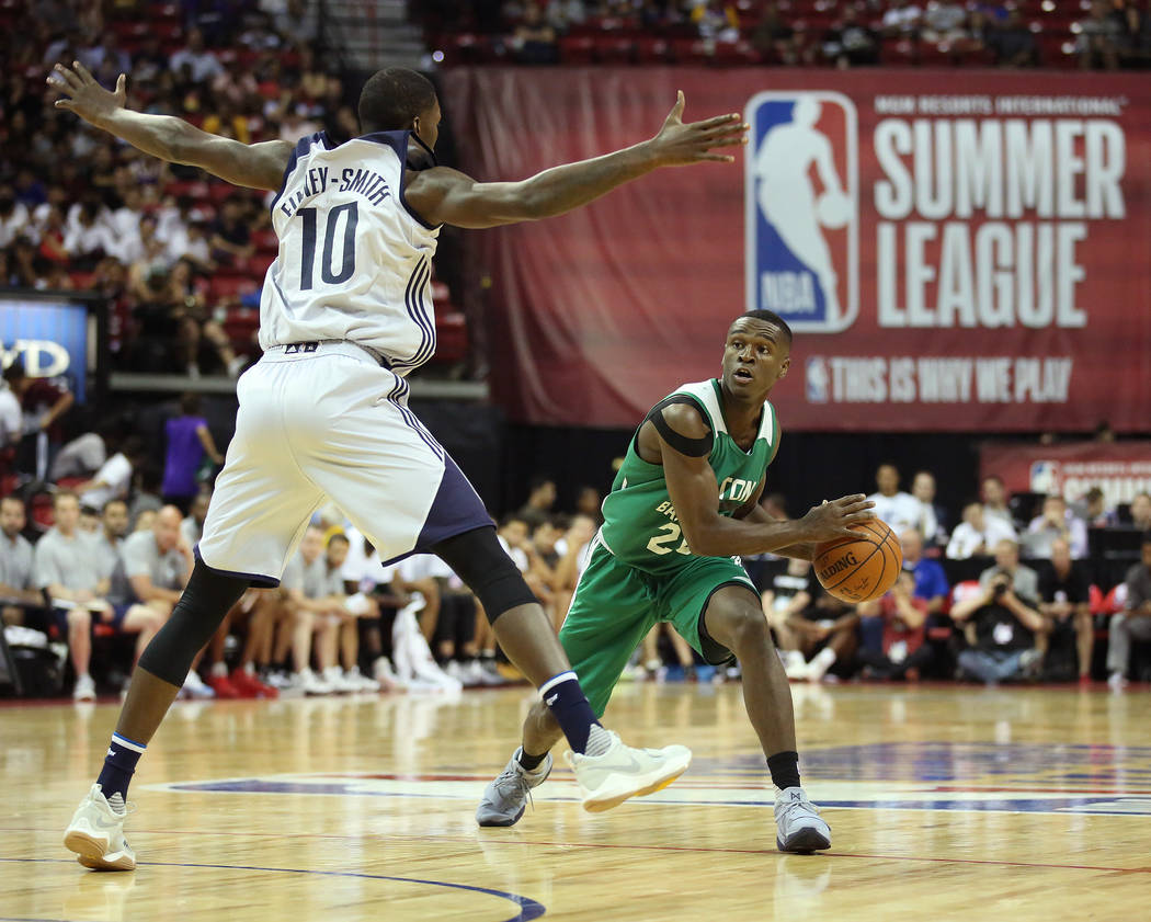 Dallas Mavericks forward Dorian Finney-Smith attempts to block Boston Celtics forward Terran Petteway's pass during their 2017 NBA Summer League game at Thomas & Mack in Las Vegas on Saturday, ...