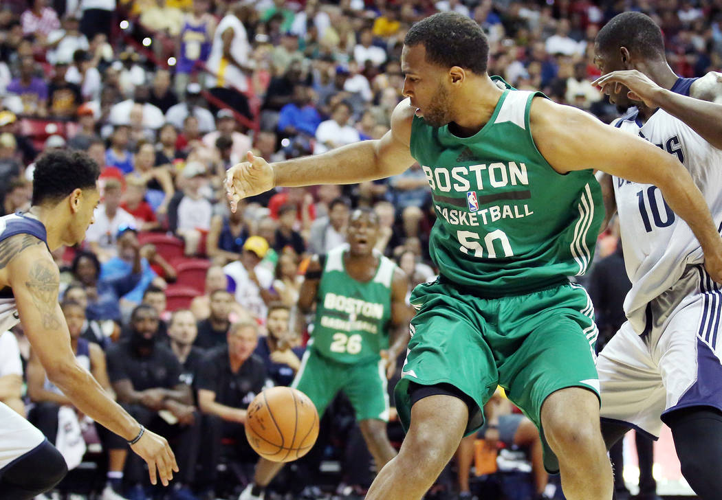 Boston Celtics center Trevor Thompson looses possession of the ball to the Dallas Mavericks during their 2017 NBA Summer League game at Thomas & Mack in Las Vegas on Saturday, July 15, 2017. B ...