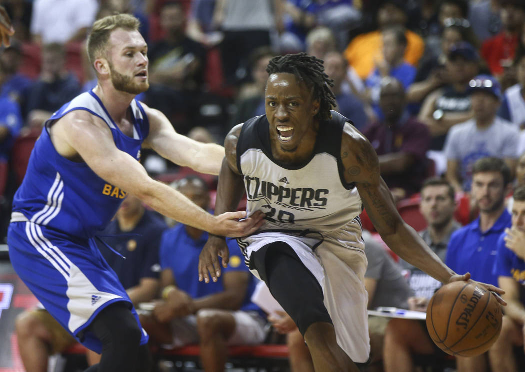 Los Angeles Clippers' Jaron Johnson (28) drives past  Golden State Warriors' Bryce Alford (12) during a basketball game at the NBA Summer League at the Thomas & Mack Center in Las Vegas on Fri ...