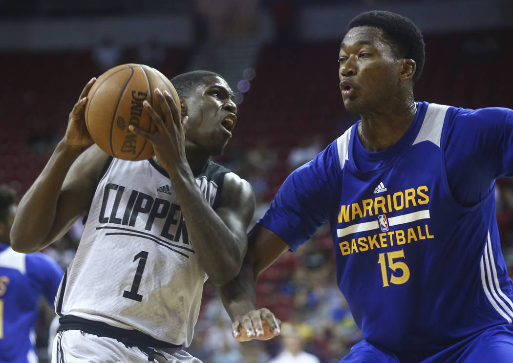 Los Angeles Clippers' Jawun Evans (1) drives to the basket against Golden State Warriors' Damian Jones (15) during a basketball game at the NBA Summer League at the Thomas & Mack Center in Las ...