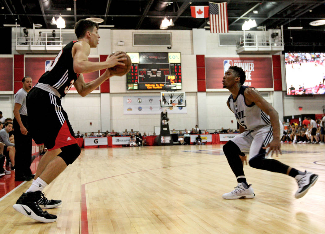 Portland Trail Blazers rookie Zach Collins (33) looks for an opening to pass the ball during the Trail Blazers NBA Summer League game against the Utah Jazz at the Cox Pavilion in Las Vegas on Satu ...