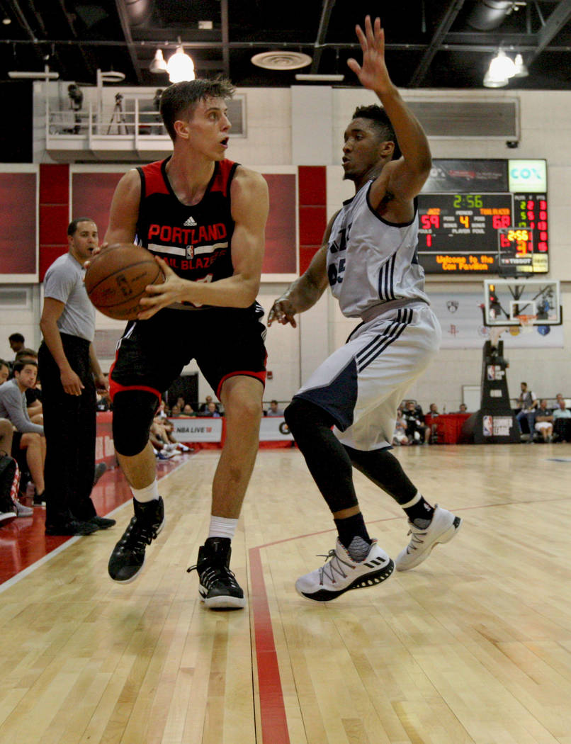 Portland Trail Blazers rookie Zach Collins (33) gets ready to pass the ball during the Trail Blazers NBA Summer League game against the Utah Jazz at the Cox Pavilion in Las Vegas on Saturday, July ...