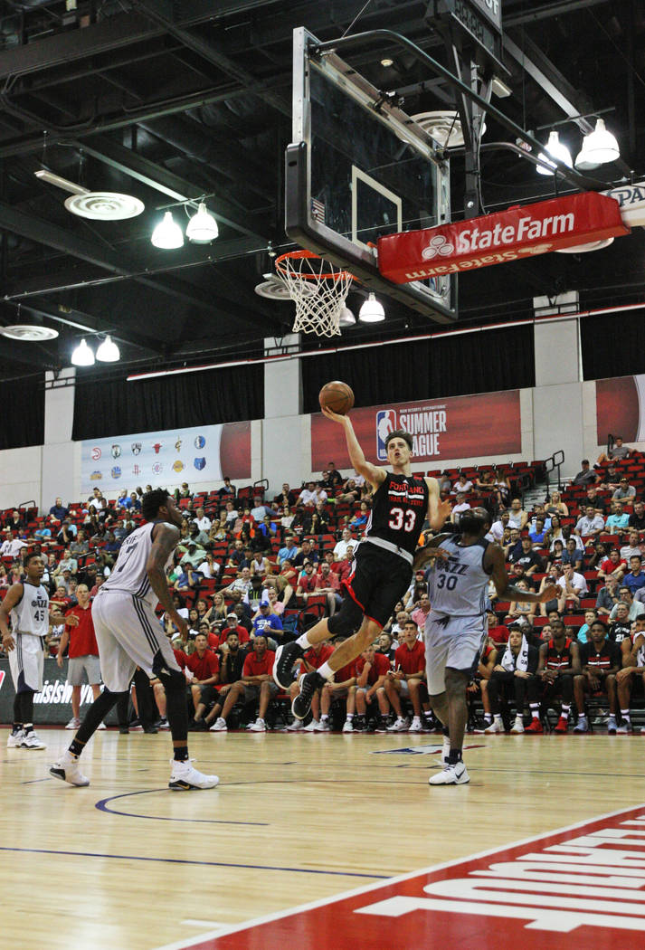 Portland Trail Blazers rookie Zach Collins (33) jumps to catch a rebound during the Trail Blazers NBA Summer League game against the Utah Jazz at the Cox Pavilion in Las Vegas on Saturday, July 8, ...