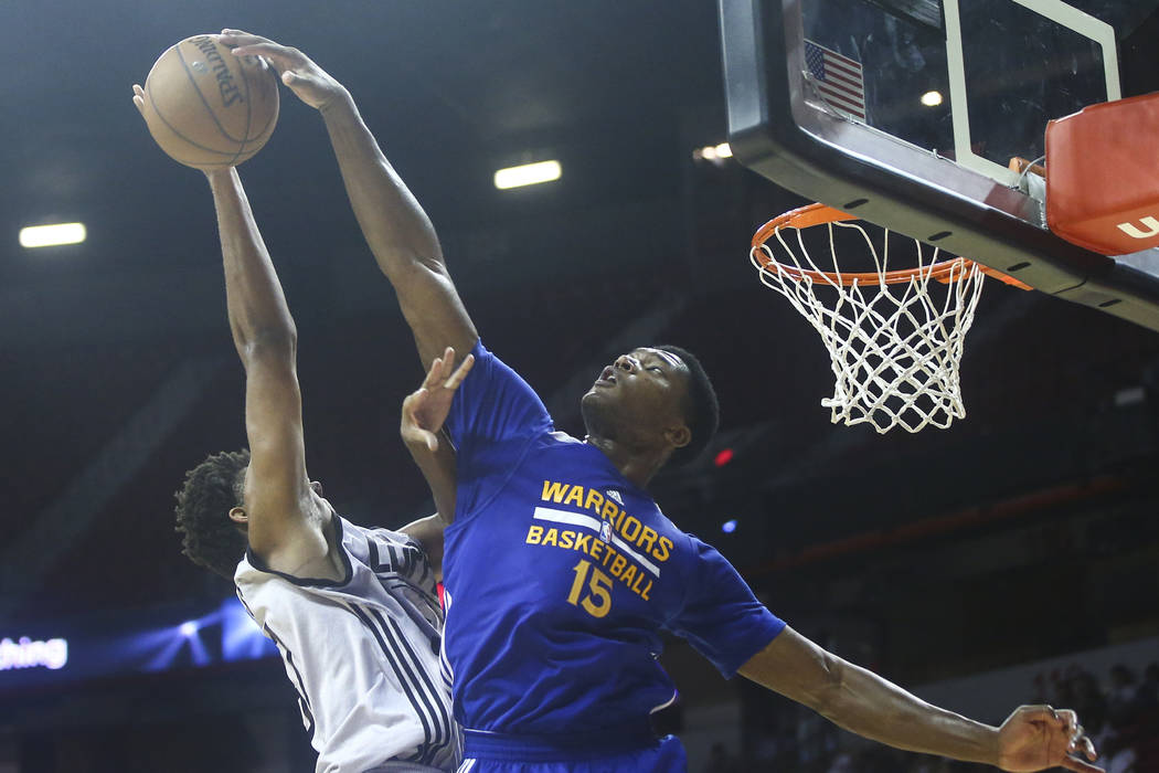 Golden State Warriors' Damian Jones (15) blocks a shot from Los Angeles Clippers' Isaiah Hicks (37) during a basketball game at the NBA Summer League at the Thomas & Mack Center in Las Vegas o ...