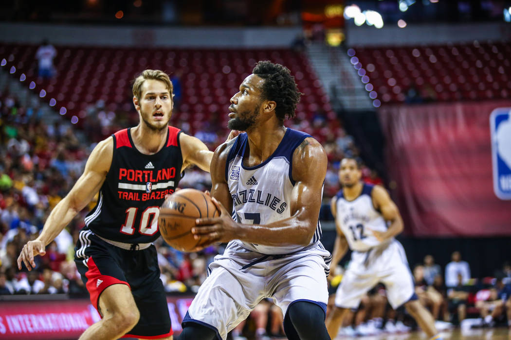 Memphis Grizzlies player Wayne Selden Jr. looks to pass against Portland Trail Blazer forward Jake Layman (10) during the NBA Summer League semifinal basketball game at Thomas and Mack Center on S ...