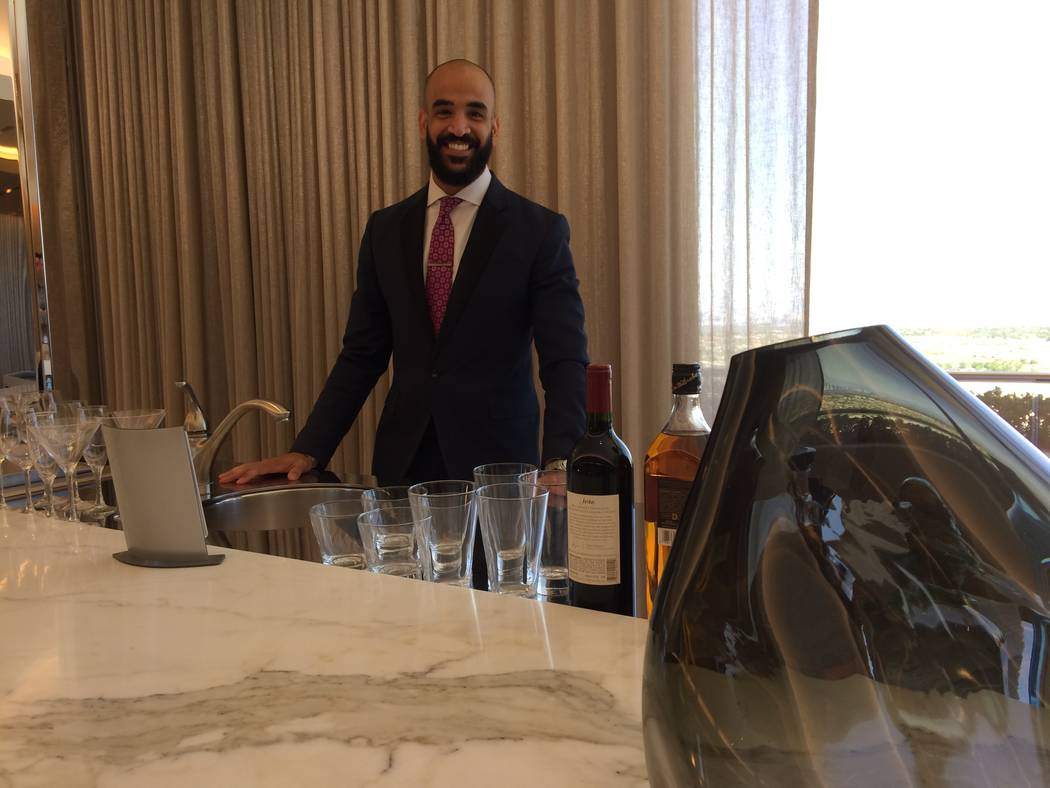 "Joseph Yalda talks June  5, 2017, about being a butler at Red Rock Resort. His job is part concierge and has seen him jump in his car to deliver left-behind show tickets, finding ""the"" preferred b ..."