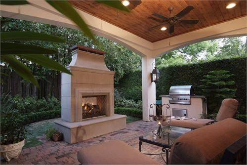 Gail Mayhugh Candles and a fireplace combine for a cozy outdoor seating area.