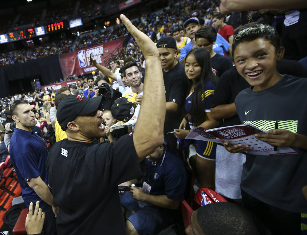 LaVar Ball, father of Los Angeles LakersՠLonzo Ball, left, at halftime during a basketball game between the Lakers and Los Angeles Clippers at the NBA Summer League at the Thomas & Mack  ...