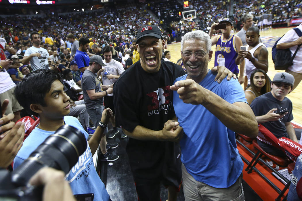 LaVar Ball, father of Los Angeles Lakers rookie Lonzo Ball, center, at halftime during a basketball game between the Lakers and Los Angeles Clippers at the NBA Summer League at the Thomas & Ma ...