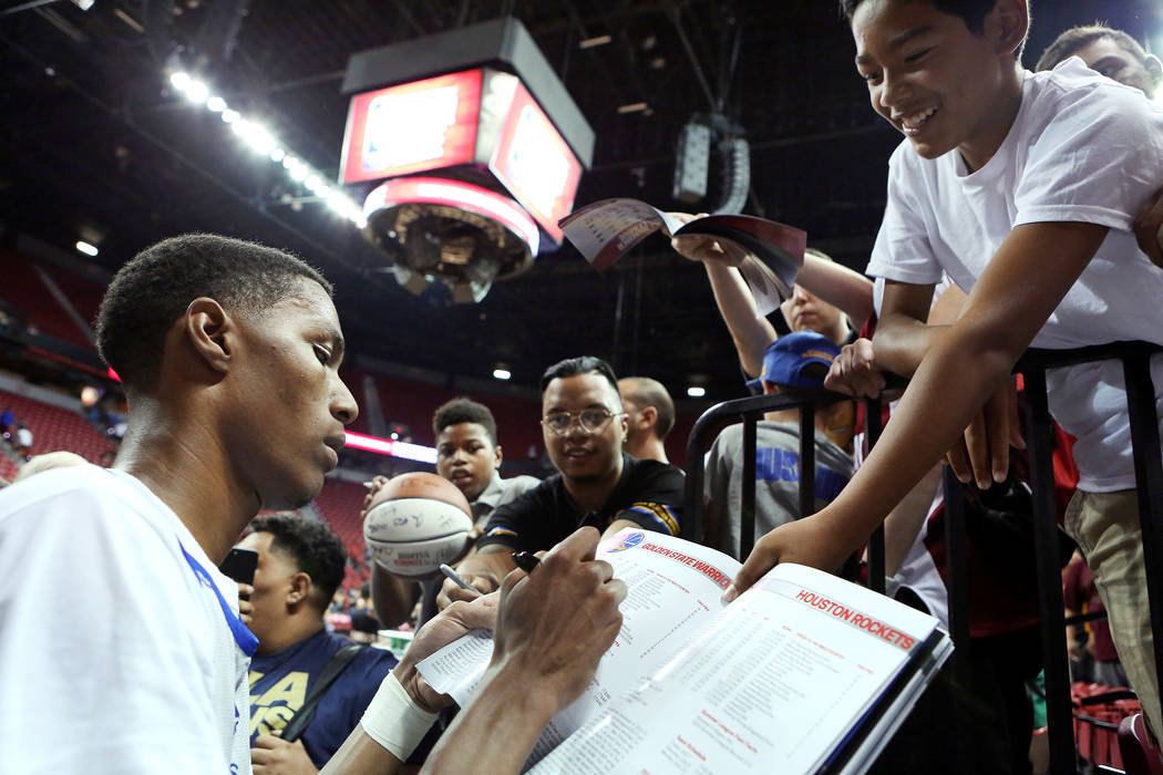 After a loss to the Philadelphia 76ers, Golden State Warriors guard Patrick McCaw sign autographs for kids after the Warriors NBA Summer League game against the 76ers at Thomas and Mack  ...