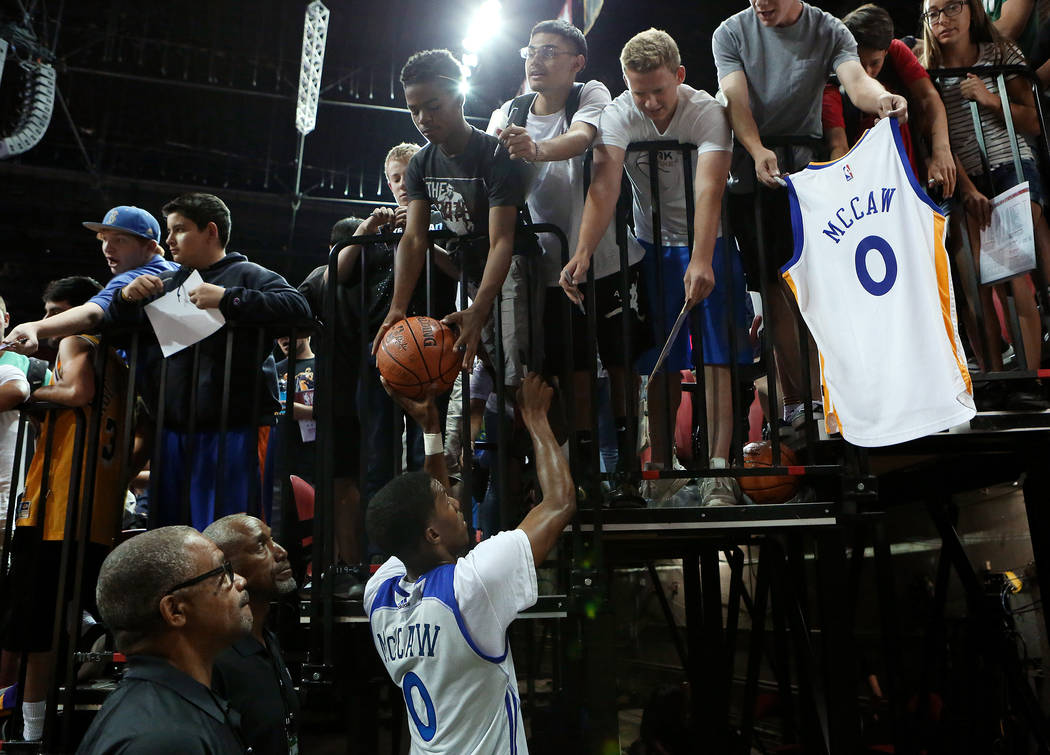 After a loss to the Philadelphia 76ers, Golden State Warriors guard Patrick McCaw sign autographs for kids after the WarriorsNBA Summer League game against the 76ersat Thomas and Mack  ...