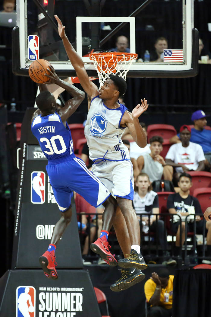 Golden State Warriors center Damian Jones attempts to block Philadelphia 76ers guard Brandon Austin's basket during the WarriorsʎBA Summer League game against the 76ersʡt Thomas and Ma ...