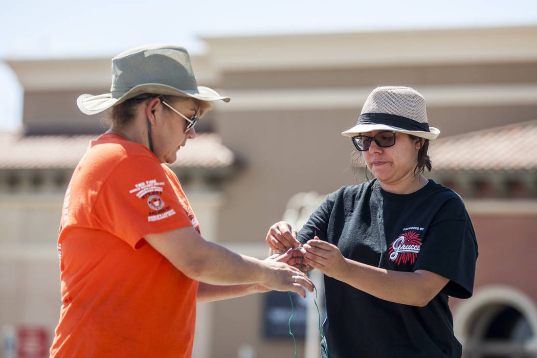 Ana Lopez, left, helps Krystal Vertichio with some wiring while setting up a Grucci fireworks display to be set off on July 4 at Green Valley Ranch Resort in Henderson on Monday, July 3, 2017. (Pa ...