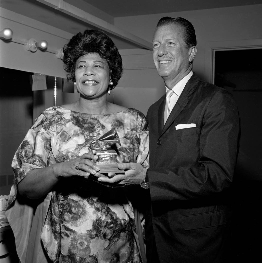 Ella Fitzgerald poses for photos as she has her Grammy Award handed to her by Van Alexander May 16, 1963, at the Flamingo in Las Vegas, Nevada. Fitzgerald had been announced the previous night as  ...