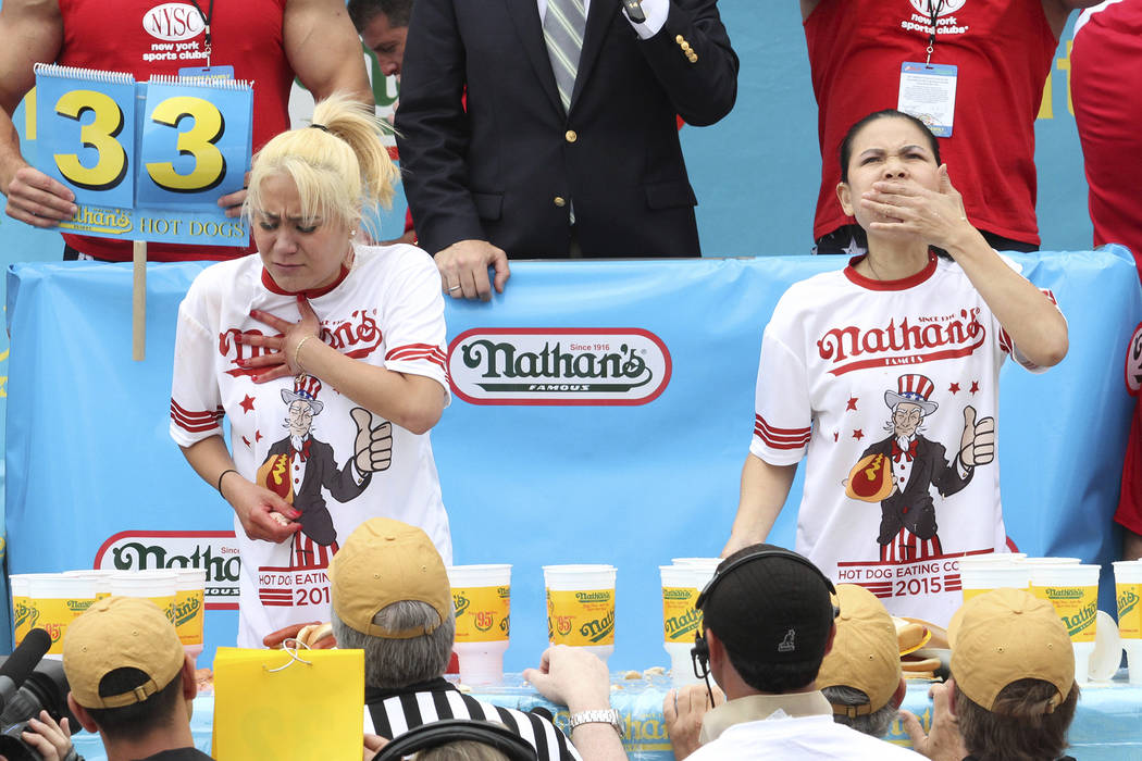 "Miki Sudo, left, and Sonya ""Black Widow"" Thomas compete in Nathan's Famous Fourth of July International Hot Dog Eating Contest women's competition Saturday July 4, 2015 at Coney  ..."