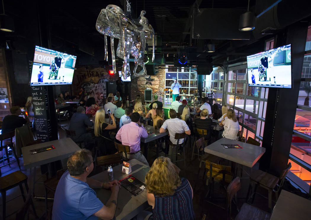 People attend the Great Love Debate at Redneck Riviera at the Grand Bazaar Shops in Las Vegas on Wednesday, June 28, 2017. Chase Stevens Las Vegas Review-Journal @csstevensphoto