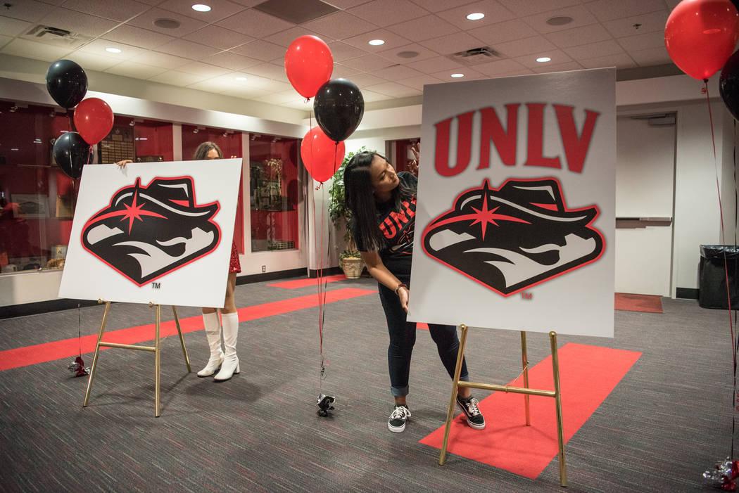 Anne Reyas prepares the new logo for viewing purposes at the UNLV Thomas & Mack Center on Wednesday, June 28, 2017, in Las Vegas. Morgan Lieberman Las Vegas Review-Journal