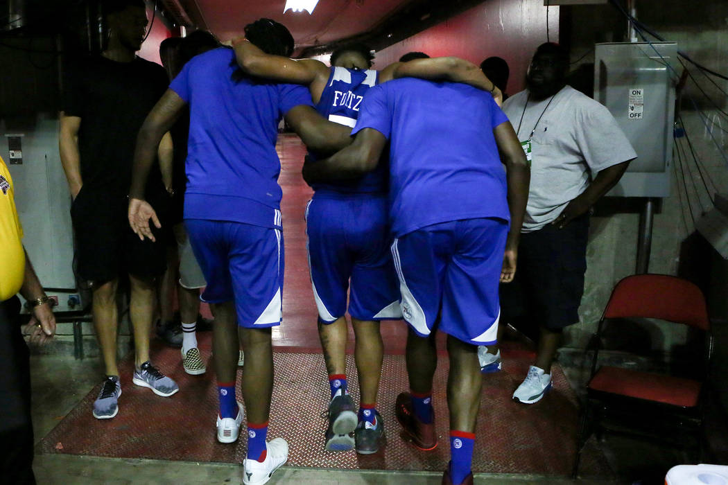 Philadelphia 76ers guard Markelle Fultz is carried off the court by teammates during the 76ers NBA Summer League game against the Golden State Warriors at Thomas and Mack Center in Las V ...