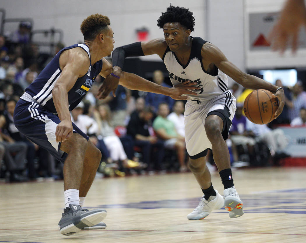 Sacramento King's De'Aaron Fox (5) dribbles past Memphis Grizzlie's Wade Baldwin IV (4) during the NBA Summer League on Sunday, July 9, 2017, at the Thomas & Mack Center in Las Vegas. Rachel A ...