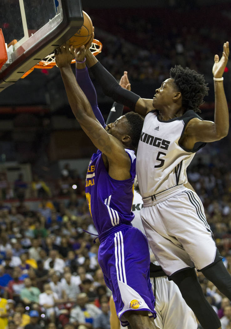 Sacramento Kings point guard De'Aaron Fox, right, and Los Angeles Lakers guard David Nwaba vie for the ball during the NBA summer league at the Thomas & Mack Center in Las Vegas, Monday, July  ...