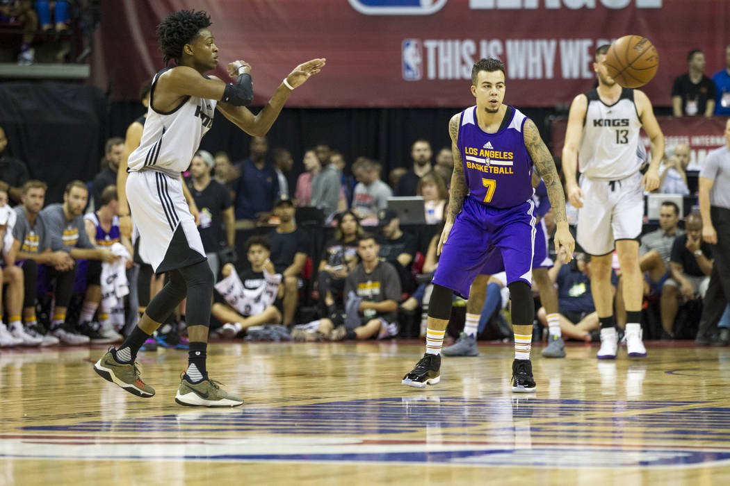 Sacramento Kings point guard De'Aaron Fox, left, passes the ball against Los Angeles Lakers during the NBA summer league at the Thomas & Mack Center in Las Vegas, Monday, July 10, 2017. Richar ...