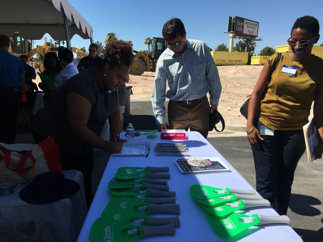 Guests of the non-profit campus groundbreaking gather around the Nevada Hand table before the event starts on June 29, 2017, off of Boulder Highway. The non-profit campus, which is a partnership b ...