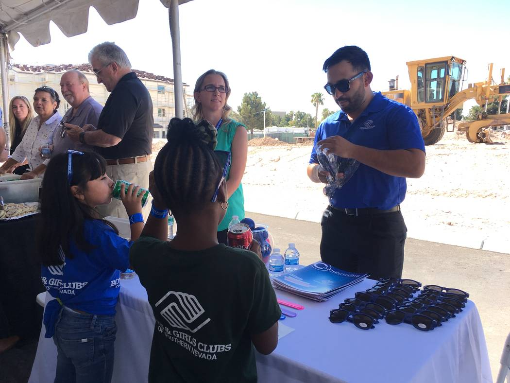 An employee of the Boys and Girls Club of Southern Nevada hands out free merchandise to guests of the non-profit campus groundbreaking on June 29, 2017, off of Boulder Highway. The non-profit camp ...