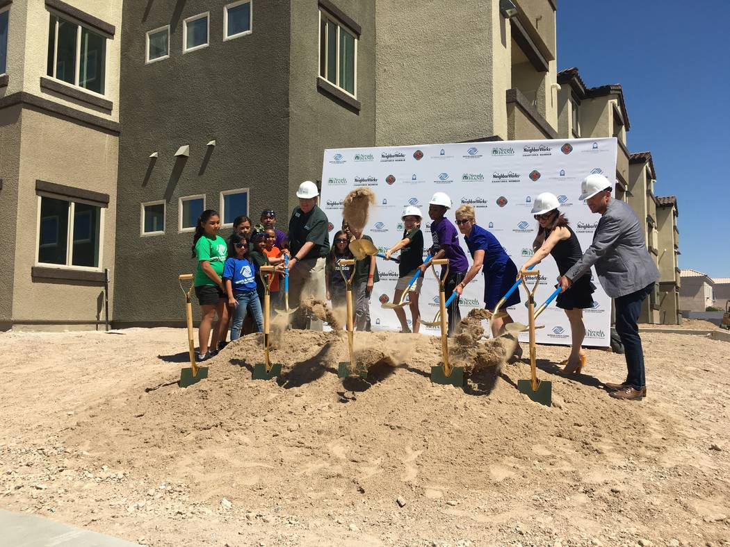 Leaders of Nevada Hand, Boys and Girls Club of Southern Nevada and Lutheran Social Services of Nevada and Clark County commissioner Chris Giunchigliani broke ground on their new non-profit campus  ...