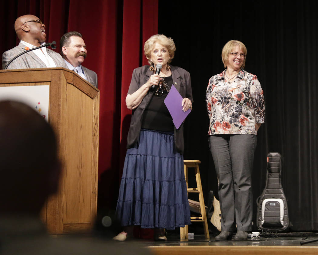 Pastor Michael Hatch, left, Pastor Troy Martinez, center left, Mayor Carolyn Goodman (center right) and Pat Richards, Mistress of Ceremony, share a laugh at the Historic Fifth Street School in Las ...