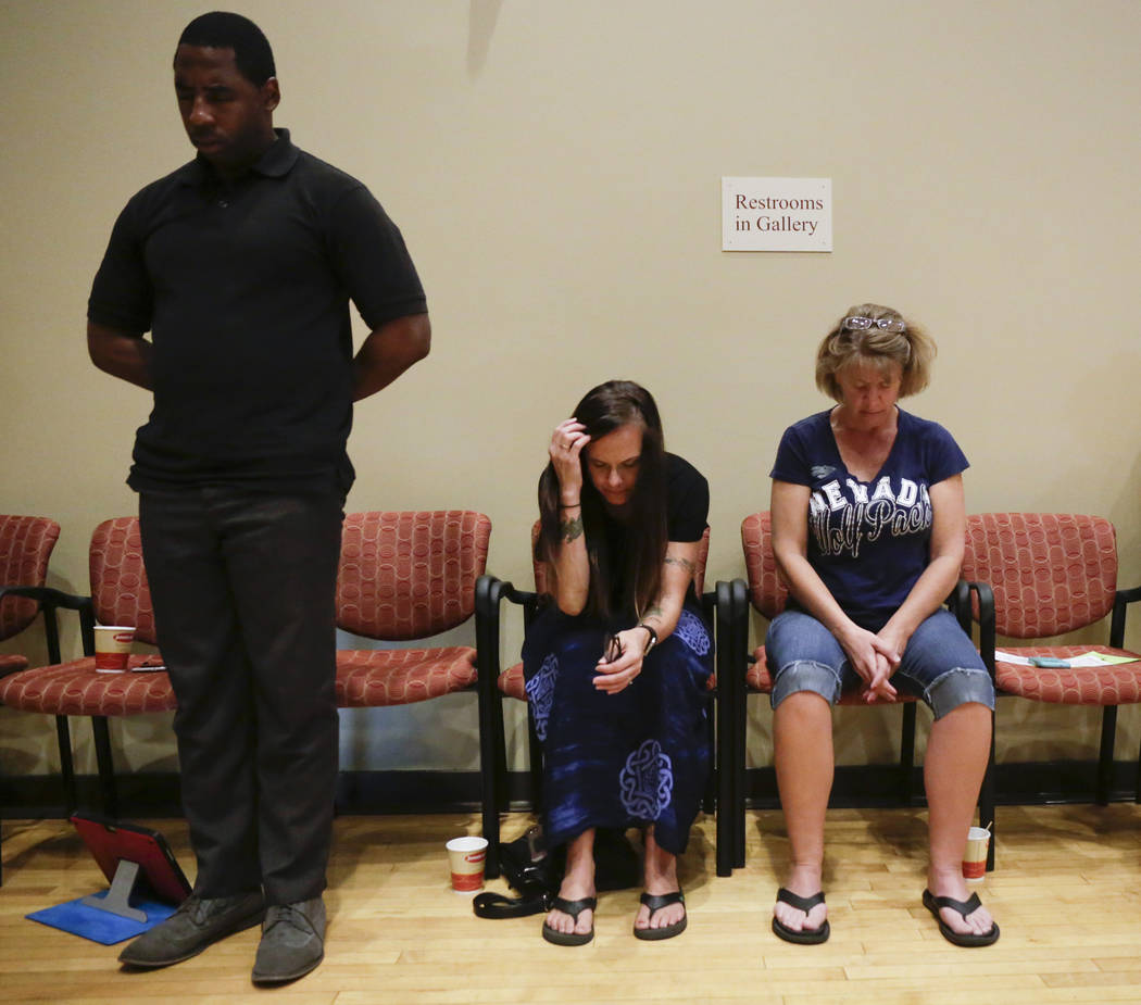 People gather to pray at the Historic Fifth Street School in Las Vegas, Saturday,July 8, 2017.  (Gabriella Angotti-Jones Las Vegas Review-Journal @gabriellaangojo)