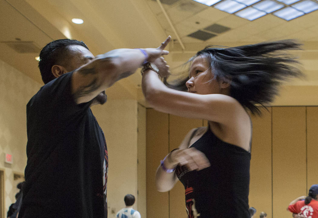 Octavio Ibanez, left, dances with Xuan Ho during a workshop that focuses on perfecting the spin during Las Vegas Salsa Bachata Congress at the Tropicana hotel-casino in Las Vegas, Sunday, July, 2, ...
