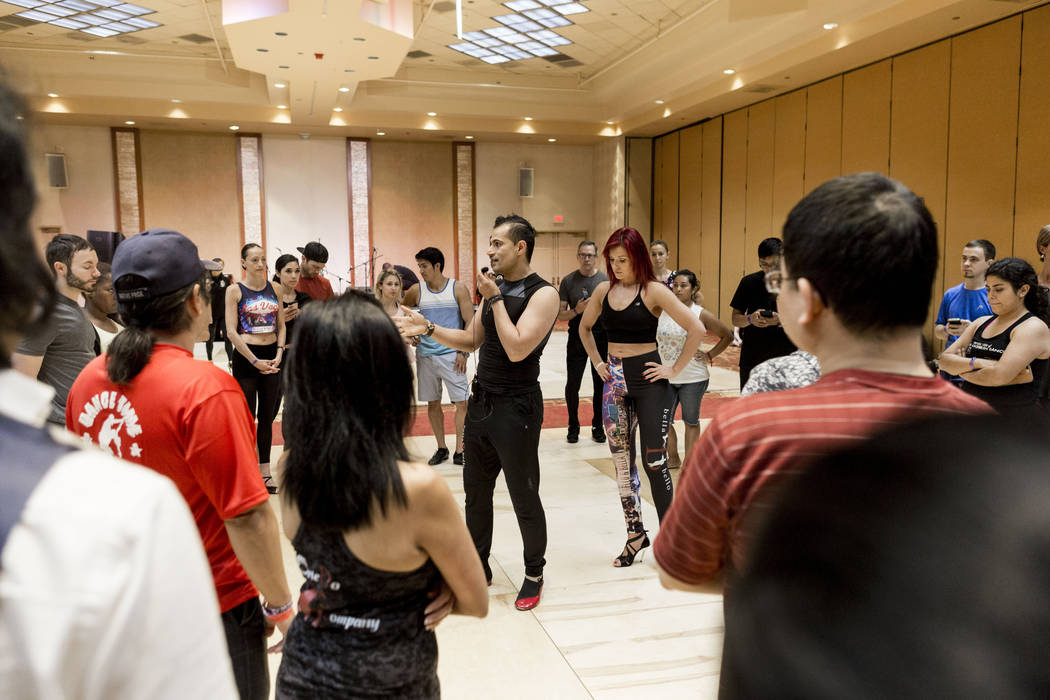 Bella and Bello instructors Gino Alvaro, left, and Ania Daniela teach a workshop on perfecting your spin during Las Vegas Salsa Bachata Congress at the Tropicana hotel-casino in Las Vegas, Sunday, ...