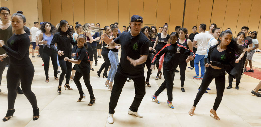 Director of Yamulee Salsa Dance Company Osmar Perrones, center, teaches choreography during the Las Vegas Salsa Bachata Congress at the Tropicana hotel-casino in Las Vegas, Sunday, July, 2, 2017.  ...