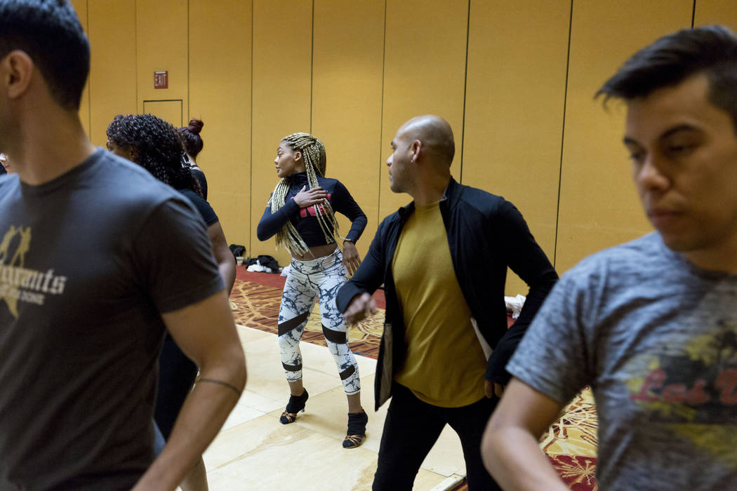 Participants learn choreography from Osmar Perrones director of Yamulee Salsa Dance Company during the Las Vegas Salsa Bachata Congress at the Tropicana hotel-casino in Las Vegas, Sunday, July, 2, ...
