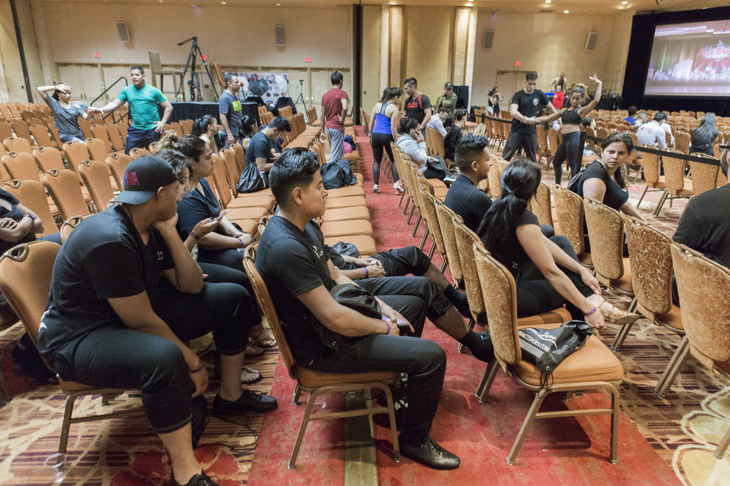 Participants of the Las Vegas Salsa Bachata Congress wait to practice their routine during technical rehearsal at the Tropicana hotel-casino in Las Vegas, Sunday, July, 2, 2017. Elizabeth Brumley  ...