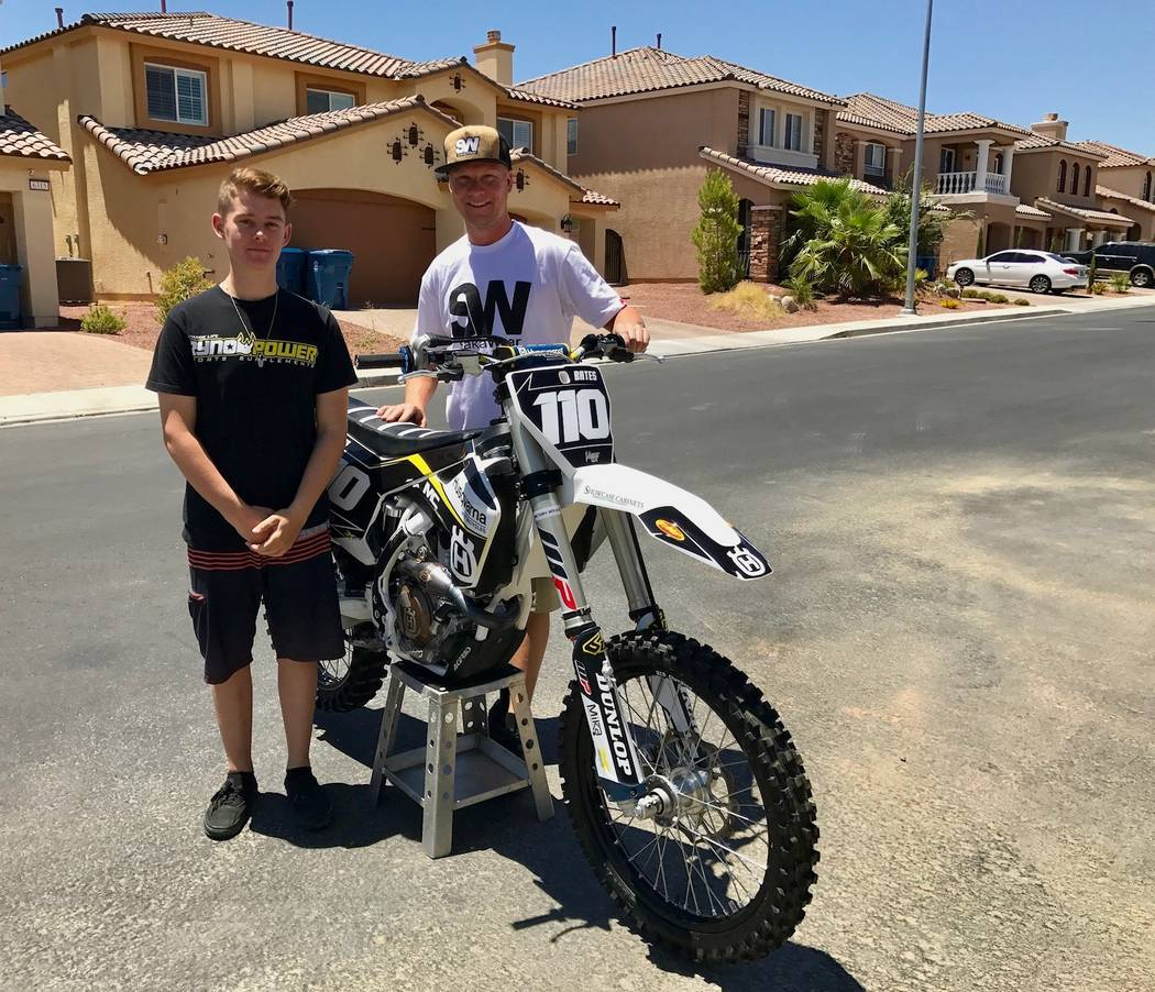 Kyle Kellett (right), 29, used to ride motocross. Now, he's partnered up with Devon Bates, 16, as his mechanic and traveling companion. (Madelyn Reese/View) @MadelynGReese