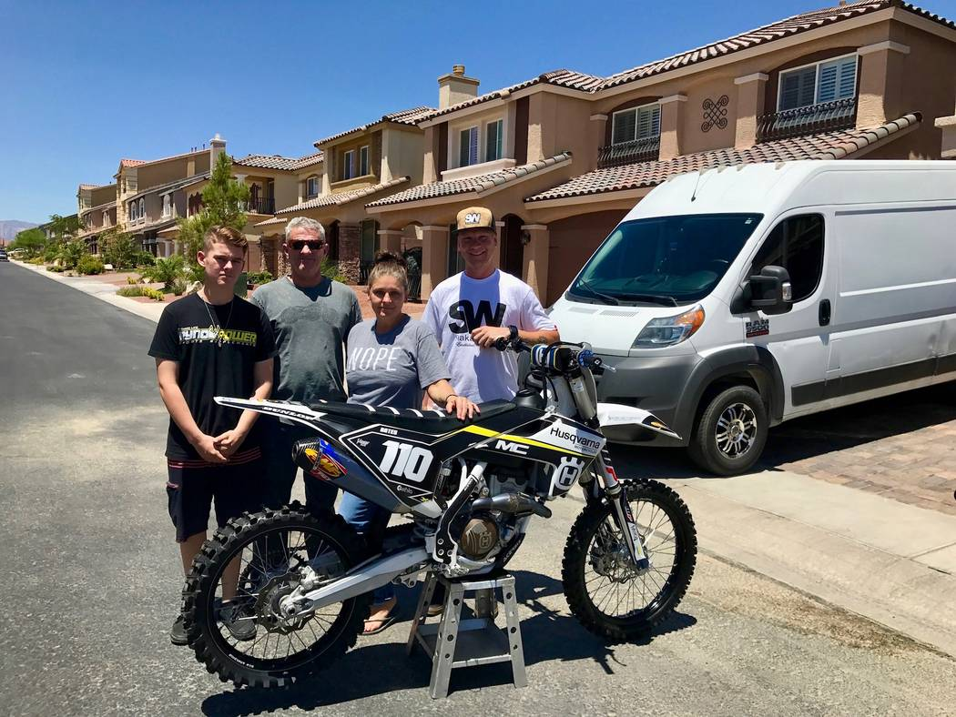 From left to right: Devon Bates, Andy Bates, Kris Kanelos-Bates and Kyle Kellett. Devon's father, Andy, said that three year's of his son's motocross travels have helped put over 100,000 miles on  ...
