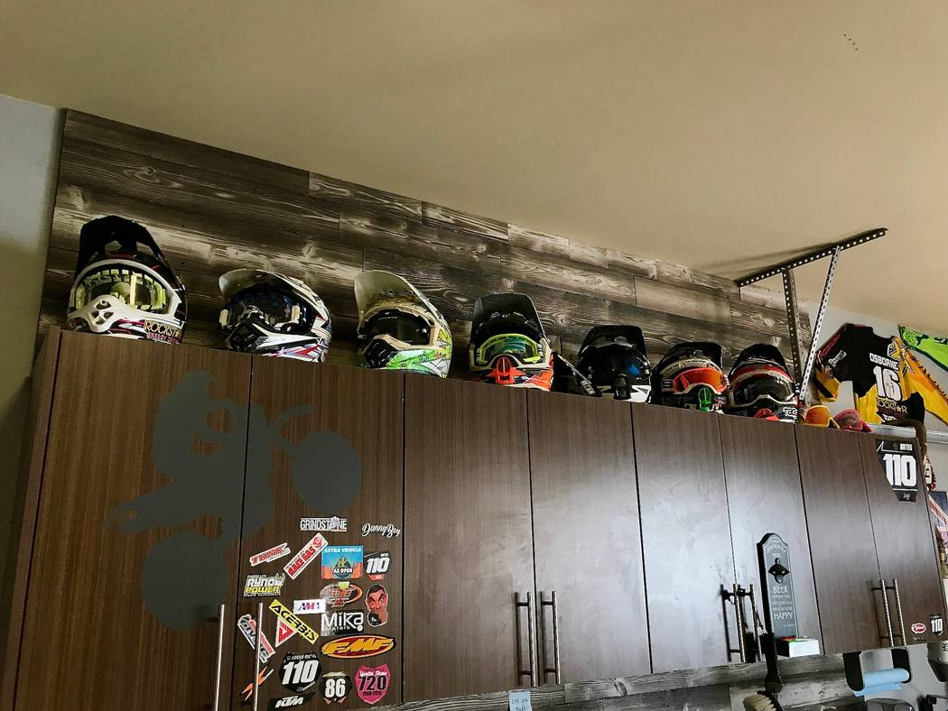 Devon's helmets and jerseys are on display in the garage at his parent's house in Las Vegas. He spends nearly nine months out of the year traveling and training with his mechanic, Kyle Kellett. (M ...