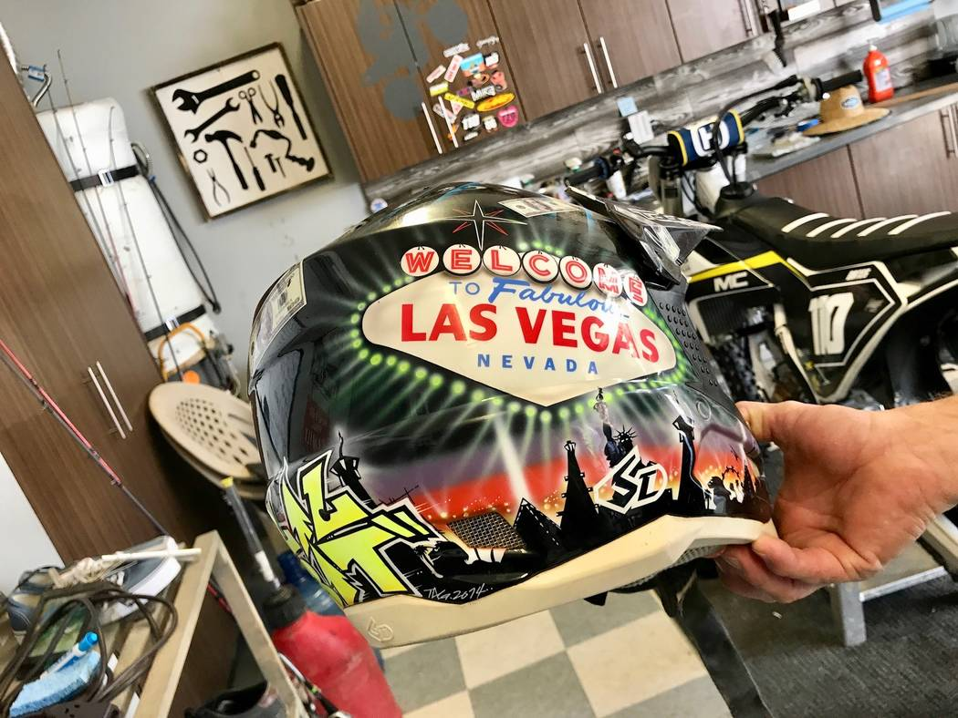 Devon keeps each of his motocross helmets in the garage. One of his favorites is customized with images of Las Vegas. (Madelyn Reese/View) @MadelynGReese