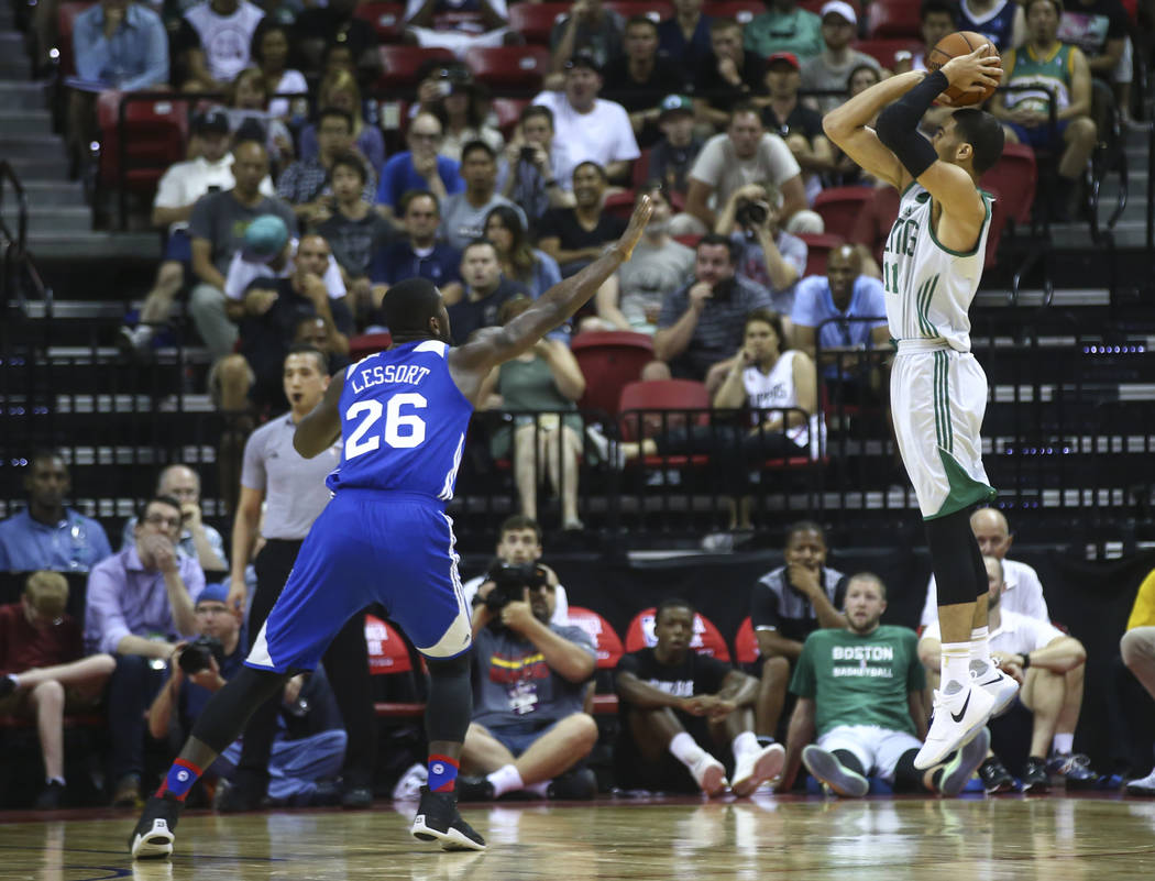Boston Celtics' Jayson Tatum (11) shoots over Philadelphia 76ers' Mathias Lessort (26) during a basketball game at the NBA Summer League at the Thomas & Mack Center in Las Vegas on Tuesday, Ju ...
