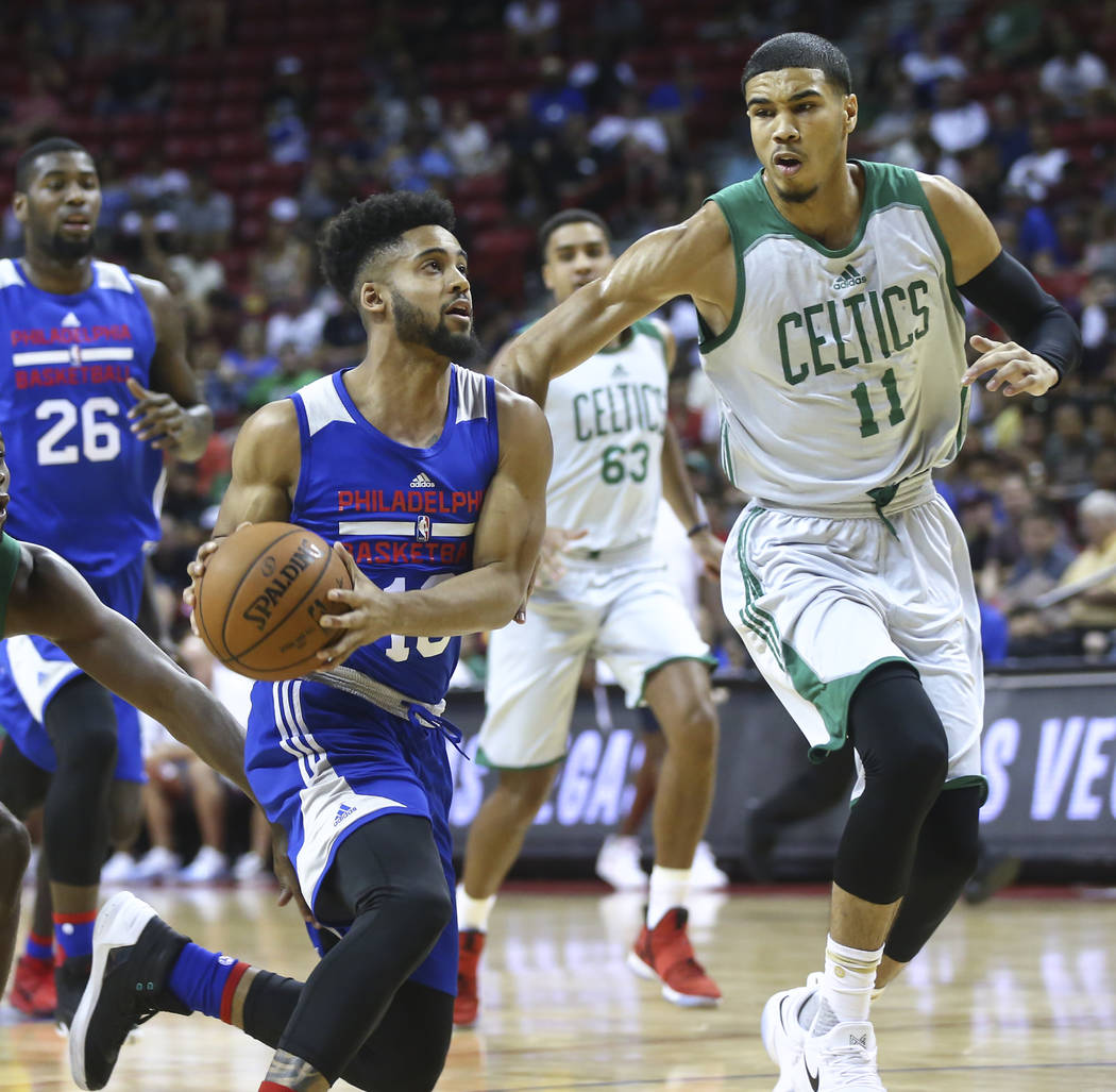 Philadelphia 76ers' Melo Trimble (18) drives against Boston Celtics' Jayson Tatum (11) during a basketball game at the NBA Summer League at the Thomas & Mack Center in Las Vegas on Tuesday, Ju ...