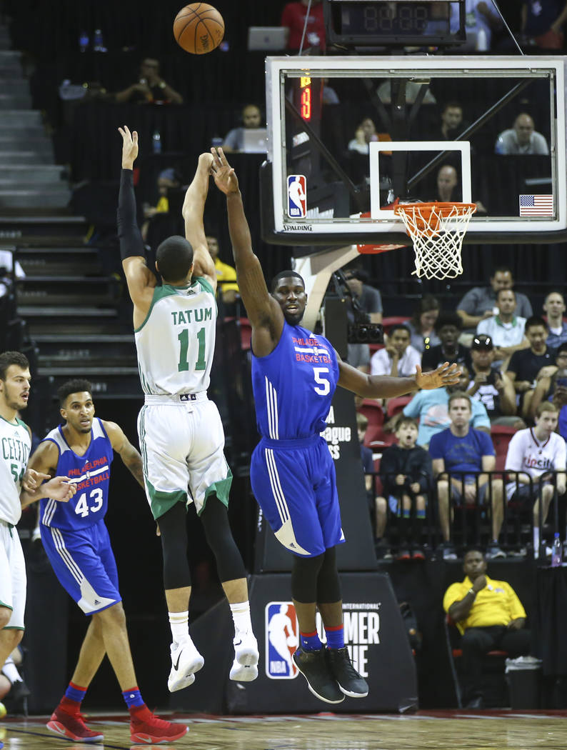 Boston Celtics' Jayson Tatum (11) shoots over Philadelphia 76ers' Alex Poythress (5) during a basketball game at the NBA Summer League at the Thomas & Mack Center in Las Vegas on Tuesday, July ...