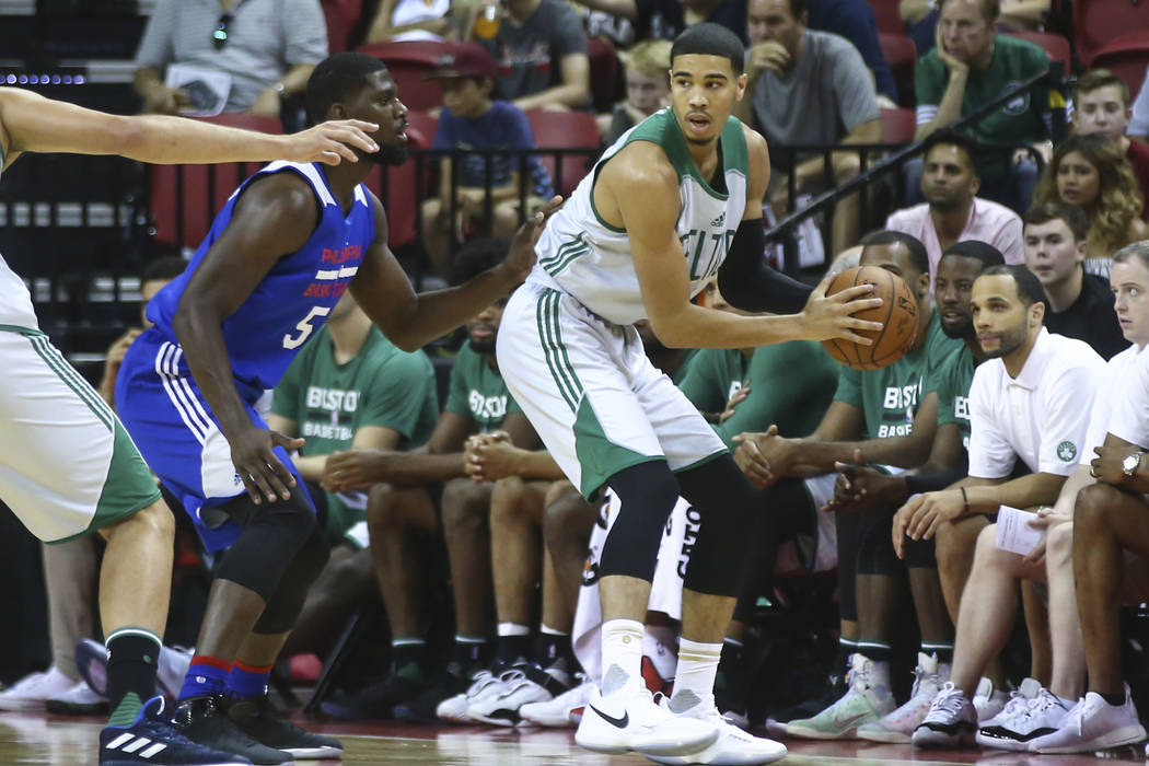 Boston Celtics' Jayson Tatum (11) drives against the Philadelphia 76ers during a basketball game at the NBA Summer League at the Thomas & Mack Center in Las Vegas on Tuesday, July 11, 2017. Ch ...