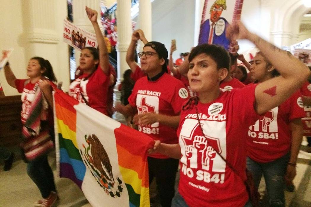 Demonstrators march in the Texas Capitol on Monday, May 29, 2017, protesting the state's newly passed anti-sanctuary cities bill in Austin, Texas. Opponents call Texas' anti-sanctuary cities law a ...