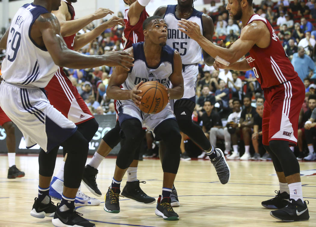 Dallas Mavericks' Dennis Smith Jr. looks for an open shot during a basketball game against the Miami Heat at the NBA Summer League at the Cox Pavilion in Las Vegas on Tuesday, July 11, 2017. Chase ...