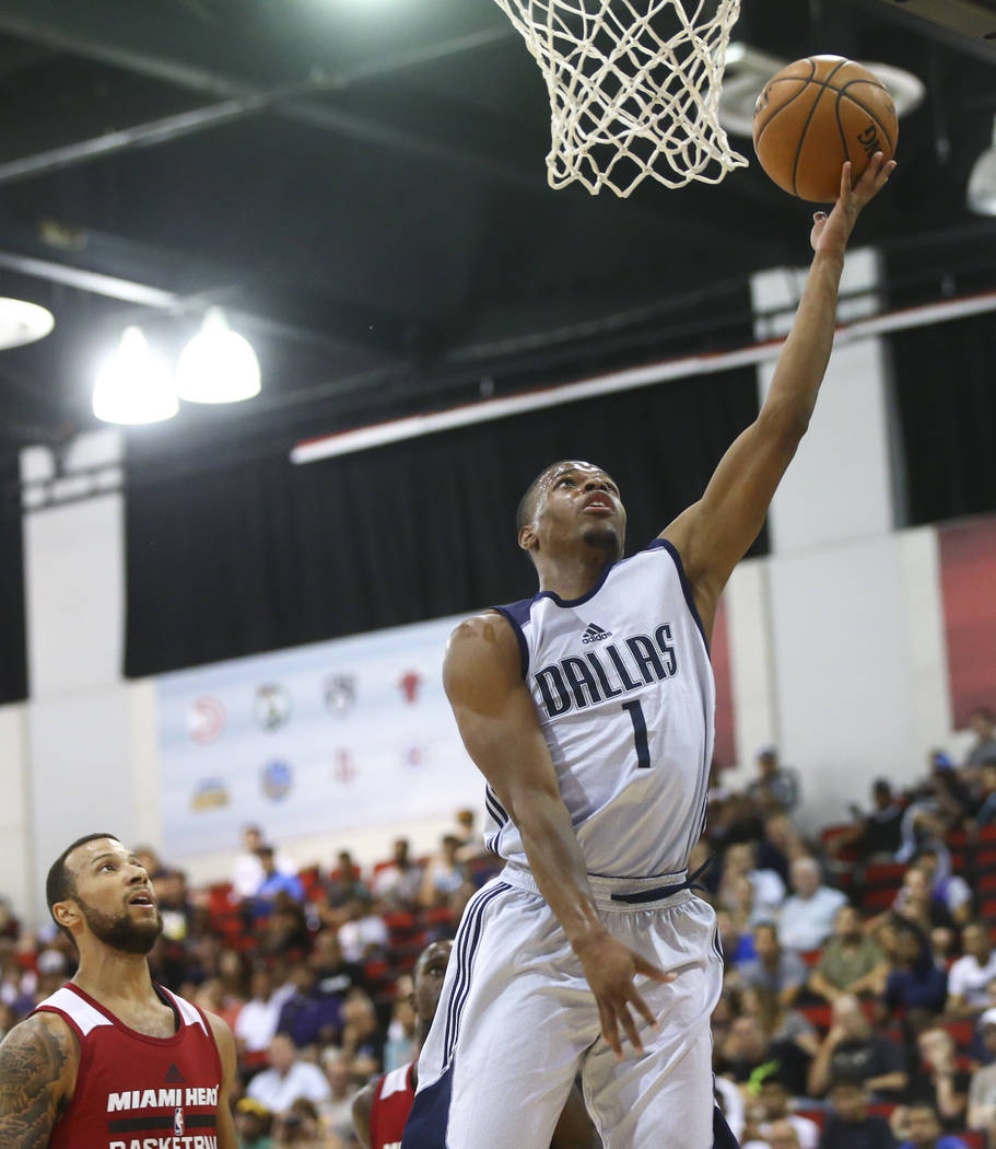 Dallas Mavericks' Dennis Smith Jr. (1) shoots over Miami Heat's Trey McKinney-Jones during a basketball game at the NBA Summer League at the Cox Pavilion in Las Vegas on Tuesday, July 11, 2017. Ch ...