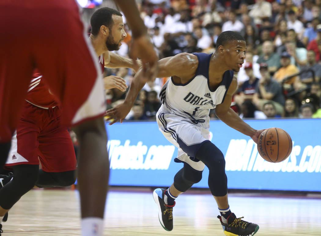 Dallas Mavericks' Dennis Smith Jr. (1) drives the ball during a basketball game against the Miami Heat at the NBA Summer League at the Cox Pavilion in Las Vegas on Tuesday, July 11, 2017. Chase St ...